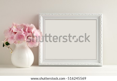 White landscape frame mock up with a vase of hydrangea beside the frame, overlay your quote, promotion, headline, or design, great for small businesses, lifestyle bloggers and social media campaigns