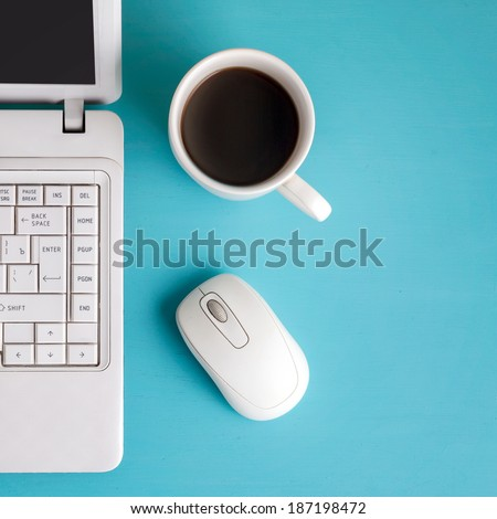 White laptop on table place for text