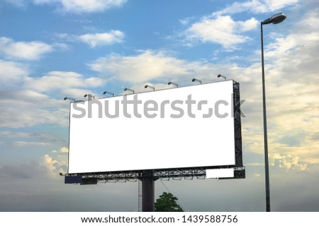 White large empty billboard with steel structure on side of road with blue sky at evening Foto stock ©