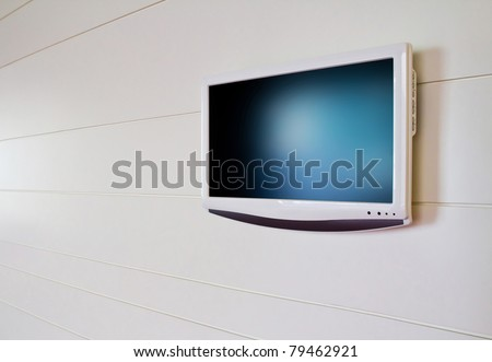 white lcd screen on white wall