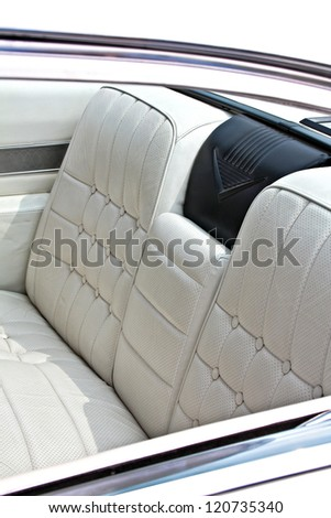 White leather backseat of a vintage car - stock photo
