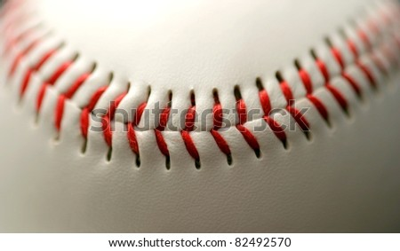white leather base ball with red stitching