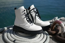 white leather boots from the new collection of fashionable shoes made of eco-leather fall-winter 2020. macro photo