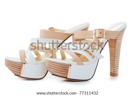 White leather female shoes on high heels isolated on white