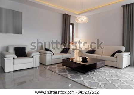 White leather furniture in elegant modern lounge #345232532