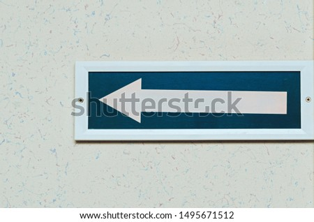 white left arrow on the wall. Pointers and signs. #1495671512