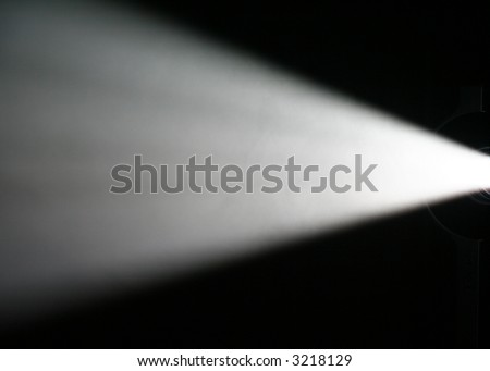 White Light Beam from Projector on Black Background