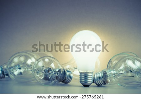 White light bulb glowing among the others #275765261