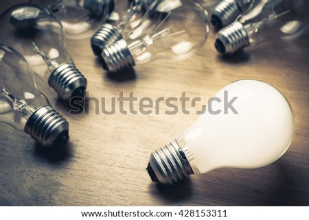 White light bulb glowing separate from the others #428153311