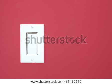 White light switch on the red wall