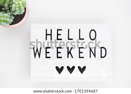 white lightbox with the words hello weekend.  Inspirational Quote. Ready to rest, do different things, have fun ... Сток-фото ©