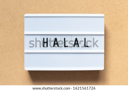 White lightbox with word halal on wood background