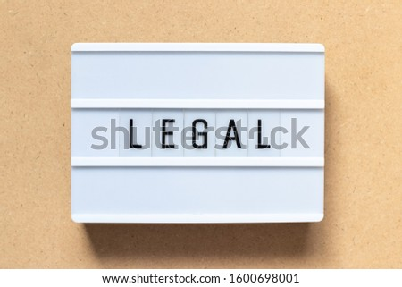 White lightbox with word legal on wood background