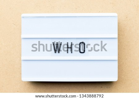 White lightbox with word who on wood background
