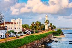 White lighthouse on tropical island on sunset. Fort Galle. Sri Lanka