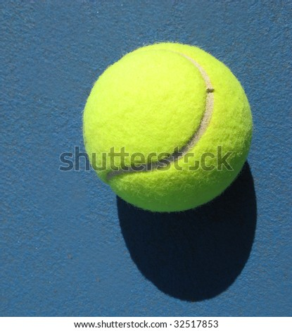 White line of tennis court and ball, sunny day, shadow
