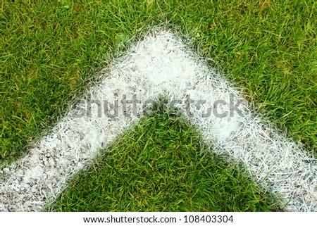 White line on green grass football pitch