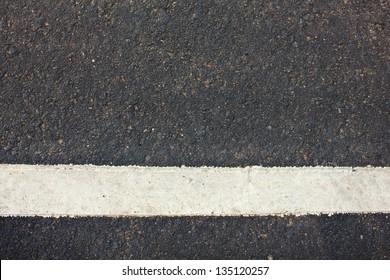 Stock Photo - white lines on asphalt