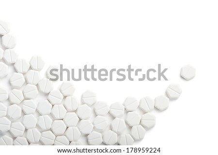 white little pills on white background with copy space
