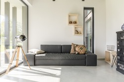 White living room with black furniture and window
