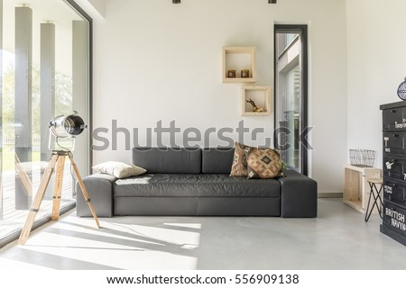 White living room with black furniture and window #556909138