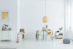 White loft with dining table, chairs and dresser