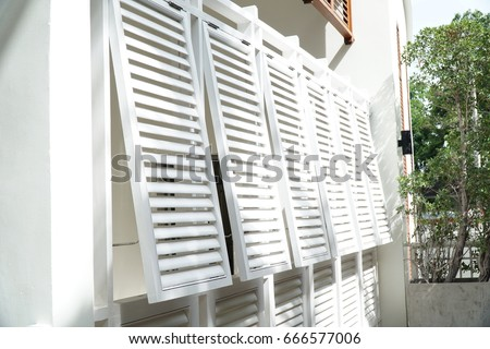 White louver window on the wall of the hotel.