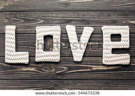 white love letters word on wooden rustic background. greeting card concept. happy valentines day. wedding invitation #544673338
