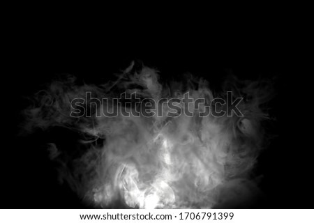 White luminous isolated abstract chaotic puffs of smoke on black background