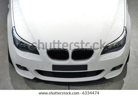 White luxury car - front/top view