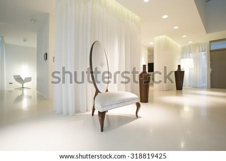 White luxury interior with modern designed furniture