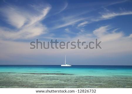 White luxury yacht anchored near famous summer resort Atoll Rangiroa. French Polynesia