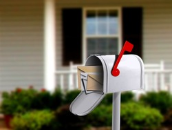 White Mail Box in Front of a House