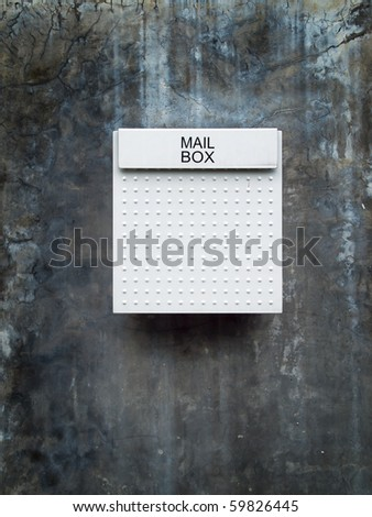 White mail box on grunge old wall