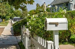 white mailbox by the family house