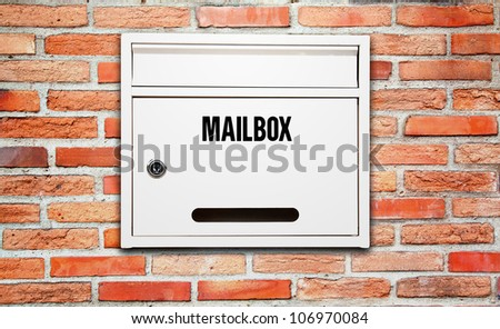 White Mailbox on old Brick Wall