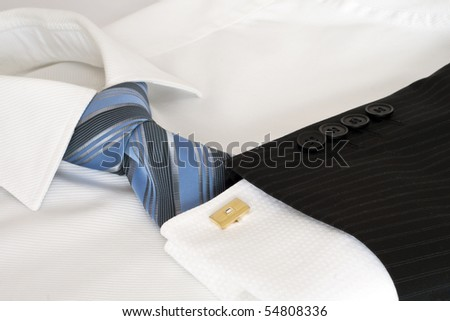 White male shirt, blue tie.
