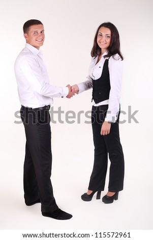 White man and woman - business handshake