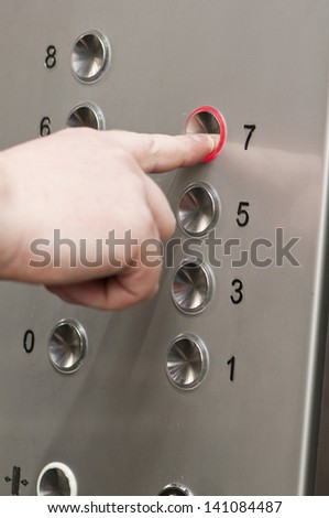 white man pushing buttons on an elevator