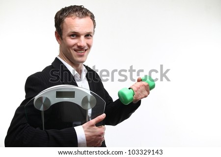 white man with a scale and apple