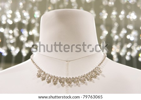 white mannequin with a wedding necklace