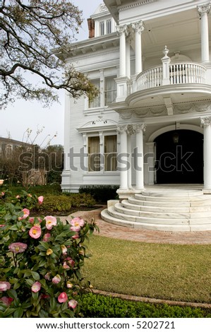 White mansion in traditional style in New Orleans' Garden district - stock photo