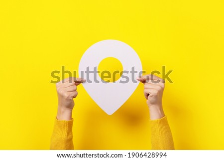 white map pointer 3d pin  in hand over yellow background Photo stock ©