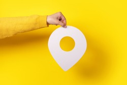 white map pointer 3d pin. Location symbol in hand over yellow background