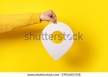 white map pointer 3d pin. Location symbol in hand over yellow background Photo stock ©