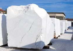 White marble blocks. Depot of  marble factory, work stone in Italy. Selective focus.