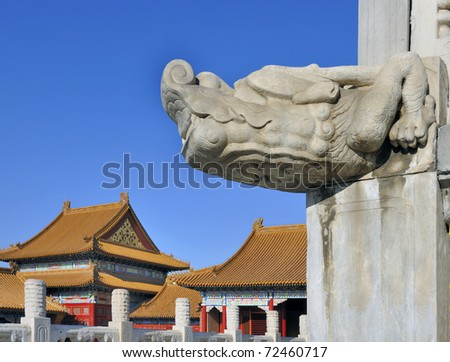 White marble gargoyle in the Forbidden City, Beijing,China against clear blue sky.
