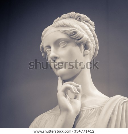 White marble head of young woman. - Shutterstock ID 334771412