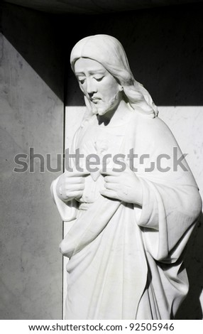 White marble sculpture of Jesus and His Sacred Heart