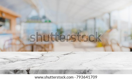 White marble stone table top and blurred restaurant interior background - can used for display or montage your products.